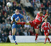 Photo: Chris Ratcliffe.<br />Leyton Orient v Grimsby Town. Coca Cola League 2. 17/04/2006.<br />Donny Barnard (R) of Leyton Orient nicks the ball away from Gary Jones of Grimsby