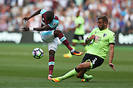 Enner Valencia of West Ham United has a shot  blocked by Steve Cook of Bournemouth. Premier league match, West Ham Utd v AFC Bournemouth at the London Stadium, Queen Elizabeth Olympic Park in London on Sunday 21st August 2016.<br /> pic by John Patrick Fletcher, Andrew Orchard sports photography.