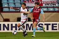 Lewis Spence ,Antoni Sarcevic during the EFL Sky Bet League 2 match between Scunthorpe United and Bolton Wanderers at the Sands Venue Stadium, Scunthorpe, England on 24 November 2020.