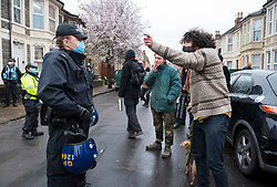 © Licensed to London News Pictures; 10/03/2021; Bristol, UK. A man remonstrates with police as squatters are evicted from a large empty office building by Police and bailiffs on Gloucester Road in North Bristol. The squatters say they are called The Pigeon Shit Collective, because of the Government's failings, and they are giving support to homeless people and those in need during the covid-19 coronavirus pandemic. Photo credit: Simon Chapman/LNP.