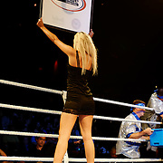 """June 19, 2009 - Richmond, BC - Rumble at the Rock IV - A ring girl displays the round card between rounds at the Canadian Light Heavyweight title fight..Heavyweight fighters Junior Moar of Richmond, BC, and Abdallah Ramadan of Toronto, Ontario, squared off in a ten round bout for the Canadian Light Heavyweight Title. Ramadan's record going into the fight was 15-8-0 with nine wins by KO. Junior """"The Real Deal"""" Moar's record was 6-2-0 with two wins by KO. .Moar won the Canadian light heavyweight title Friday night when Ramadan was disqualified in the sixth round after seemingly never ending series of low blows..The River Rock Casino Resort hosted the West Coast Promotions Rumble at the Rock VI boxing event at the River Rock Show Theatre."""