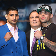 Boxer Amir Khan (left) poses with opponent Luis Collazo during the undercard final press conference for the Mayweather & Maidana boxing match at the Hollywood Theater, inside the MGM Grand hotel on Thursday, May 1, 2014 in Las Vegas, Nevada.  (AP Photo/Alex Menendez)