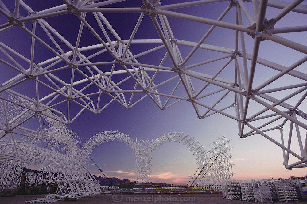 Biosphere 2 Project buildings under construction seen at dawn. The Biosphere was a privately funded experiment, designed to investigate the way in which humans interact with a small self-sufficient ecological environment, and to look at possibilities for future planetary colonization.  1989