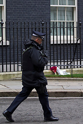 © Licensed to London News Pictures. 09/04/2013. London, UK. The day after her death tributes to former British Prime Minister Baroness Thatcher  are seen outside Number 10 Downing Street in London today (09/04/2013). Photo credit: Matt Cetti-Roberts/LNP