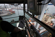 A high lift crane  work  loading ships on the Ports of Auckland    , North Island ,New Zealand   , New Zealand  on Sept 5th  2014   Photograph by Brendon O'Hagan /Bloomberg News