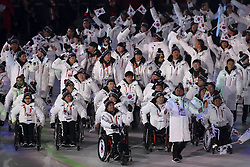 March 9, 2018 - Pyeongchang, GANGWON, SOUTH KOREA - March 09, 2018-Pyeongchang, South Korea-Members of Team South Korea enter the stadium during the opening ceremony of the PyeongChang 2018 Paralympic Games at the PyeongChang Olympic Stadium in Pyeongchang, South Korea. (Credit Image: © Gmc via ZUMA Wire)