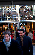 Men walking past a Topman / Topshop store in London. Topshop is a very popular high street shopping chain.