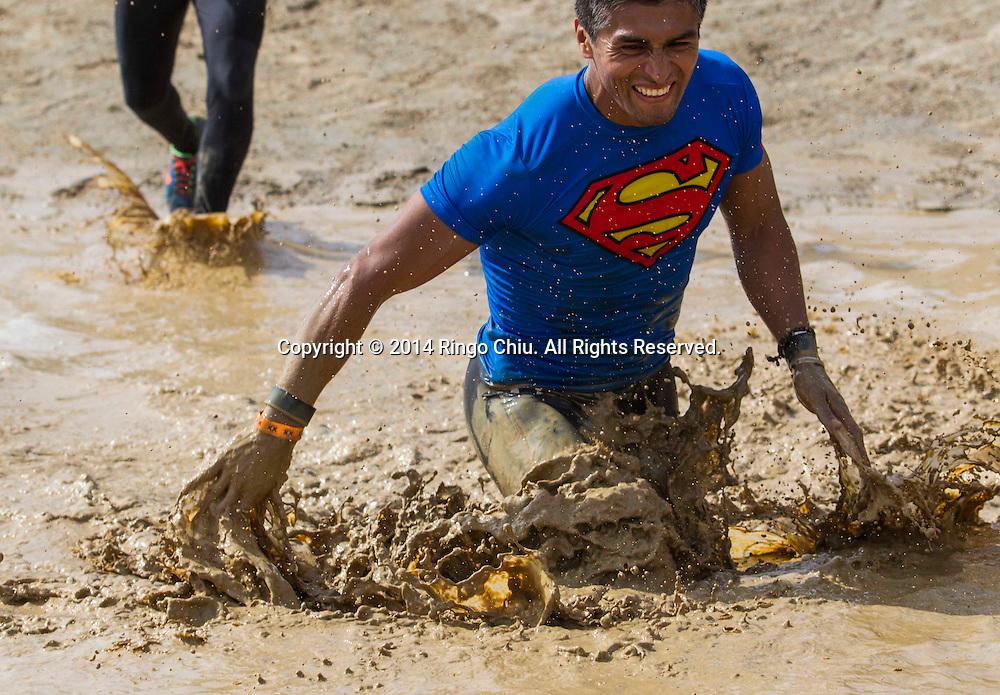 Participents take part in the  Los Angeles 2014 Tough Mudder endurance event at Glen Helen Raceway on Saturday, March 29, 2014 in San Bernadino, California. (Photo by Ringo Chiu/PHOTOFORMULA.com)