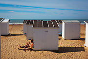 Sunbathing, beach huts, Ostend, coastal city in Belgium