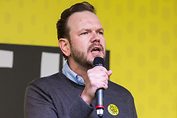 London, UK. 23rd March, 2019. Radio presenter James O'Brien addresses a People's Vote rally in Parliament Square following a march by a million people from Park Lane.