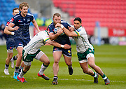 Sale Sharks hooker Akker Van Der Merwe is held by London Irish Centre Theo Brophy-Clews and Centre Curtis Rona during a Gallagher Premiership Round 14 Rugby Union match, Sunday, Mar 21, 2021, in Eccles, United Kingdom. (Steve Flynn/Image of Sport)