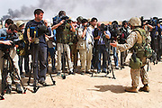 The military public relations team moved in as soon as the oil field were secure to herd a bus load of journalists so that they could report on the firefighting effort by Boots and Coots, Rumaila oil field, southern Iraq. Rumaila is also spelled Rumeilah.