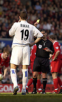 Photo. Jed Wee, Digitalsport<br />Liverpool v Leeds United, FA Barclaycard Premiership, Anfield, Liverpool. 23/03/2003.<br />Referee Andy D'Urso shows Leeds' Eirik Bakke the yellow card.