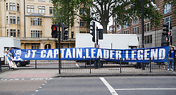 © London News Pictures. 13/07/2012. London, UK. Chelsea FC supporters holding a banner supporting John Terry reading 'JT CAPTAIN, LEADER, LEGEND' outside  Magistrates court on July 13, 2012, where a verdict  of not guilty was returned today in John Terry's trial for allegedly using a racist obscenity about Queens Park Rangers player Anton Ferdinand. Photo credit: Ben Cawthra/LNP.
