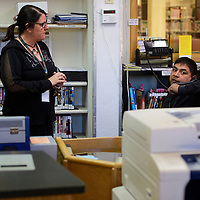Library Director Tammy Moe, and library assistant Josh Longhat make the call to Gallup Police Department at the first sign of a disturbance at the library during the active shooter drill Thursday morning.
