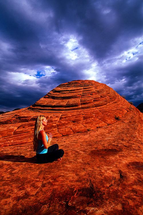 Woman doing yoga, Snow Canyon State Park, near Ivins (near St. George), Utah USA