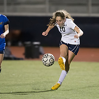 (Photograph by Bill Gerth for SVCN) Lincoln #10 Hannah Berenjfoorosh drives the ball as Prospect #2 Jordan Roue looks to defend in a BVAL Girls Soccer Game at Lincoln High School, San Jose CA on 1/27/17.  (Lincoln 2 Prospect 1 )