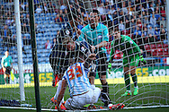 a scuffle breaks out  in the goal net after Thomas Ince of Derby County ©  scores his teams 4th goal. Skybet football league championship match, Huddersfield Town v Derby county at the John Smith's stadium in Huddersfield, Yorkshire on Saturday 18th April 2015.<br /> pic by Chris Stading, Andrew Orchard sports photography.