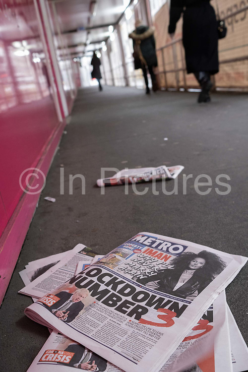 The day after the government introduced a third Coronavirus pandemic national lockdown, effectively a Tier 5 restriction, copies of the Metro newspaper lie in the street as the capital experiences a grim post-Christmas and millions of Britons are told to stay at home, on 5th January 2021, in London, England.