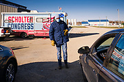 "01 NOVEMBER 2020 - CHARLES CITY, IOWA: Congressional candidate J.D. SCHOLTEN talks to voters in their cars during a drive in rally in Charles City, a community in northern Iowa. Scholten, a Democrat from Sioux City, Iowa, is running against Randy Feenstra, a Republican, in the 2020 general election on November 3. Iowa's 4th district, centered in the agricultural and sparsely populated northwest corner of the state, is the largest congressional district in Iowa and encompasses about ⅓ of the state of Iowa. Because of the COVID-19 pandemic Scholten has transitioned to drive rallies rather than in person. Scholten is on his ""Every Town Tour 2020."" He is visiting all 375 towns in the 39 counties in the district.         PHOTO BY JACK KURTZ"