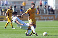 Mansfield's Matt Green (l) fouls Newport's Mark Randall. Skybet EFL league two match, Newport county v Mansfield Town at Rodney Parade in Newport, South Wales on Saturday 6th August 2016.<br /> pic by Carl Robertson, Andrew Orchard sports photography.