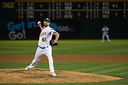 Oakland Athletics relief pitcher John Axford (61) pitches against the Miami Marlins at Oakland Coliseum in Oakland, Calif., on May 23, 2017. (Stan Olszewski/Special to S.F. Examiner)