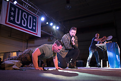 December 21, 2017 - Sevilla, Spain - Chef Robert Irvine challenges a Marine while simultaneously performing a cooking demonstration during the Chairmans USO Holiday Tour at Moon Air Base Dec. 21, 2017. .(Credit Image: