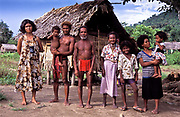 In a small village live  a tiny community of native (aboriginal) people known as AGTAS. Seen here is Borseg Lisiday and his wife Batangas and their extended family, Gumacas bay, Philippines