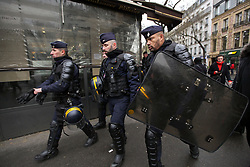 19 January 2019. Paris, France.<br /> Gilets Jaunes - Acte X take to the streets of Paris. CRS Riot police deploy along the route. An estimated 7,000 people took part in the looping 14 km route from Place des Invalides to protest tax hikes from the Government of Emmanuel Macron imposed on the people. An estimated 80,000 people took part in protests across the country. Regrettably the movement has attracted a violent element of agitators who often face off with riot police at the end of the marches which tends to deflect attention away from the message of the vast majority of peaceful protesters.<br /> Photo©; Charlie Varley/varleypix.com