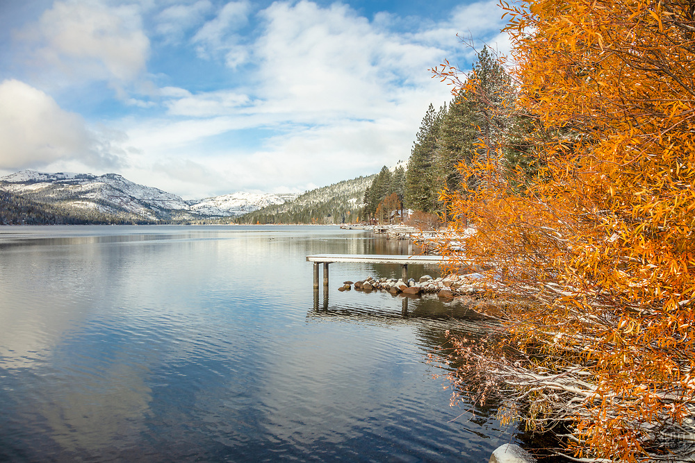 """""""Donner Lake in Autumn 17"""" - Photograph of fall foliage, snow, and a dock along the shore of Donner Lake in Truckee, California."""