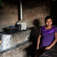 """Jesus, the Bereaved Mother. <br /> <br /> Jesús Lorenzo Martínez, Ojo de Agua, La Paz.<br /> <br /> """"I don't know how old I am. I have three girls and a boy. I'm on my own, bringing them up on my own is a struggle, a battle. Six, I had, I had six children but two are dead. Two boys died. They were for God, they weren't for me, they were for God. One went when he was a month old. The other went when he was one year and four months. Sometimes I grieve. I conform, it's God's will. But I am afraid when one gets ill. I can't get ill or no one will look after them.<br /> <br /> One of the girls is working in San Miguel (El Salvador), may God bless her and look after her and protect her. My kids are like me, they are as big as me now, and they will have to struggle like I've struggled.<br /> <br /> Sometimes I sleep with a flower, and I feel like the boys are with me and I feel strong."""""""