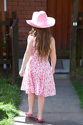 Little girl alone in the garden,