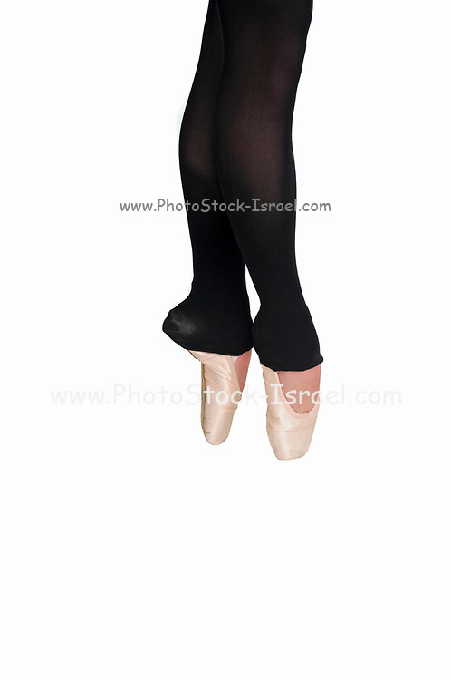 Female Ballet Dancer close up of pointed toes On white Background