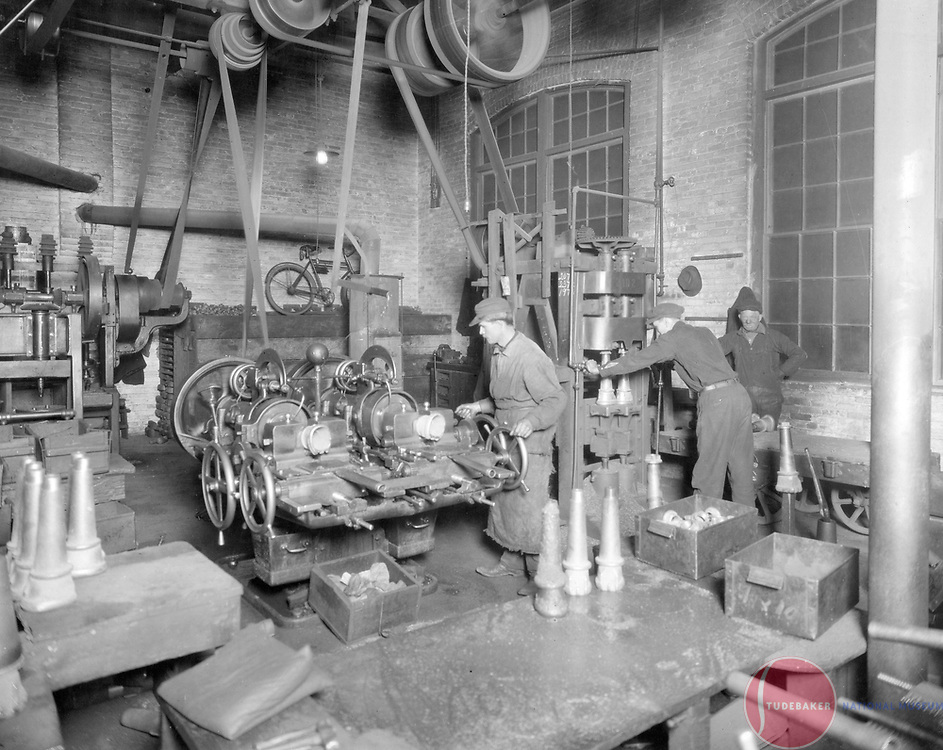 Studebaker workers machine axle skeins in this c. 1900 image.