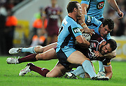 May 25th 2011: Nate Myles of the Maroons is tackled during game 1 of the 2011 State of Origin series at Suncorp Stadium in Brisbane, Australia on May 25, 2011. Photo by Matt Roberts/mattrIMAGES.com.au / QRL