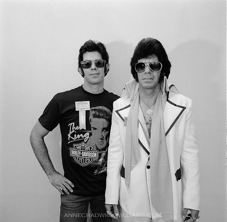 Elvis Presley impersonators at a convention for Elvis fans.