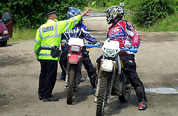 PC Naren Sagar (correct spelling) pionts out the direction taken by  one of the bikers riding illegally to officers on trial bikes during a police operation against illegal of road biking in the High Green area Sunday <br /><br />Image Copyright Paul David Drabble<br /><br />29 June 2003<br /><br />Copyright  Paul David Drabble<br /><br />[#Beginning of Shooting Data Section]<br />Nikon D1 <br /><br />2003/06/29 11:40:48.6<br /><br />JPEG (8-bit) Fine<br /><br />Image Size:  2000 x 1312<br /><br />Color<br /><br />Lens: 50mm f/1.8<br /><br />Focal Length: 50mm<br /><br />Exposure Mode: Programmed