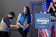 03 NOVEMBER 2020 - DES MOINES, IOWA: THERESA GREENFIELD, the Democratic candidate for the US Senate, waves to her staff before delivering her concession speech at the Renaissance Des Moines Savery Hotel after her loss in the race for the US Senate. Her husband, STEVE MILLER, left, steadied her as she went up the podium. Greenfield conceded to incumbent Republican Sen. Joni Ernst at about 11:45PM November 3.     PHOTO BY JACK KURTZ