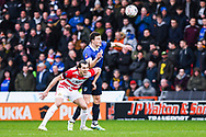 George Edmundson of Oldham Athletic (4) and John Marquis of Doncaster Rovers (9) wrestle for the aerial ball during the The FA Cup fourth round match between Doncaster Rovers and Oldham Athletic at the Keepmoat Stadium, Doncaster, England on 26 January 2019.