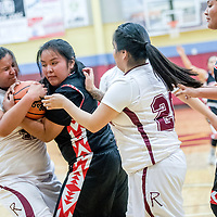 Rehoboth Lynx Kennedi Chapman (41), left, and Native American Community Academy Eagle Zaria Begay (24) tie up for a jump ball at Rehoboth High School Thursday.