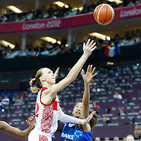 09 August 2012: Russia Irina Osipova goes for the layup past Jennifer Digbeu during 81-64 Team France victory over Team Russia, during the women's basketball semi-finals, at the 02 Arena, in London, Great Britain.