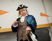 Ben Franklin (played by Phil Soinski) welcomes students during the International Printing Museum's Ben Franklin's Colonial Assembly: A Museum On Wheels at Curtner Elementary School in Milpitas, California, on May 13, 2014. (Stan Olszewski/SOSKIphoto)