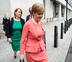 © Licensed to London News Pictures. FILE PICTURE: 14/07/2015. London, UK. Leader of the SNP and First Minister of Scotland, NICOLA STURGEON leaving BBC Broadcast House in London with her aide LIZ LLOYD (pictured left) after appearing on the Today programme on Radio 4. There are claims that Sturgeon's top political aide in government knew about the civil service probe into Alex Salmond months before the First Minister claims she found out. Photo credit: Ben Cawthra/LNP