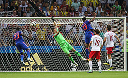 June 24, 2018 - Kazan, Russia - Yerry Mina of Colombia scores a header for his team's first goal during the Russia 2018 World Cup Group H football match between Poland and Colombia at the Kazan Arena in Kazan on June 24, 2018. Colombia won 0-3. (Credit Image: © Foto Olimpik/NurPhoto via ZUMA Press)