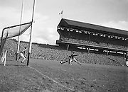 Meath is tackled by Kerry as he attempts to kick the ball into the goal during the Kerry v Meath All Ireland Senior Gaelic Football Final, 26th September 1954. Meath 1-13 Kerry 1-7.