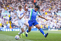 Leeds United's Jack Clarke vies for possession with Wigan Athletic's Reece James<br /> <br /> Photographer Alex Dodd/CameraSport<br /> <br /> The EFL Sky Bet Championship - Leeds United v Wigan Athletic - Friday 19th April 2019 - Elland Road - Leeds<br /> <br /> World Copyright © 2019 CameraSport. All rights reserved. 43 Linden Ave. Countesthorpe. Leicester. England. LE8 5PG - Tel: +44 (0) 116 277 4147 - admin@camerasport.com - www.camerasport.com