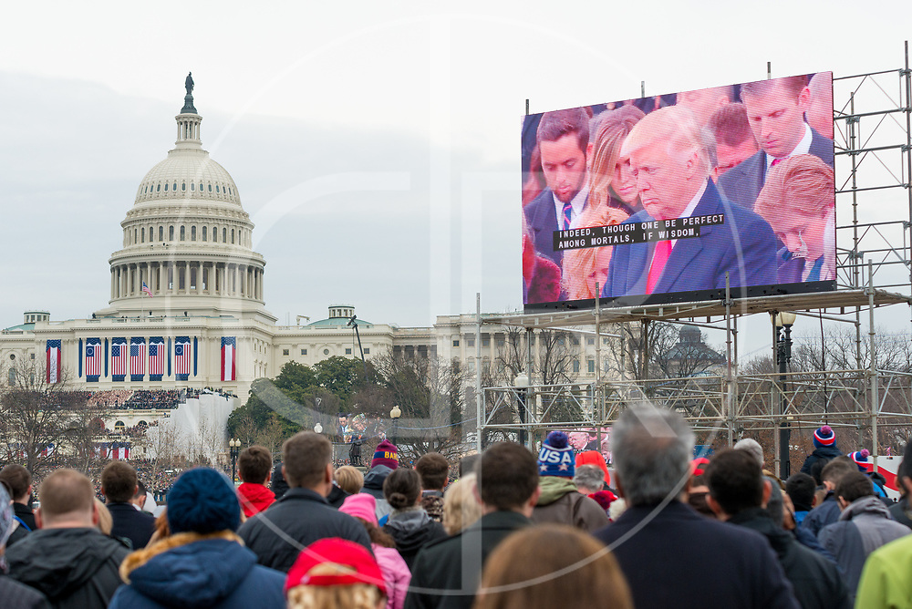 Washington DC, United States - Donald J. Trump closes his eyes in prayer during his 2017 inauguration ceremony.