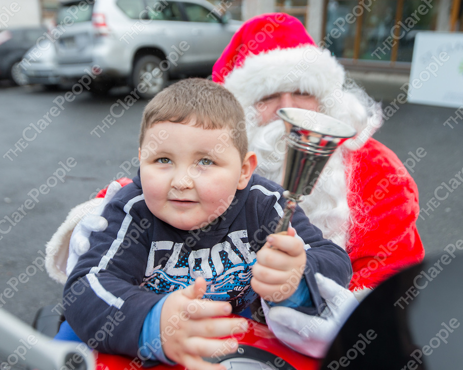 Michael James from St Clare's School rings the bell for Santa Claus