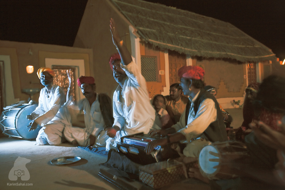 A group of musicians sing traditional songs in a village near the Thar desert in Rajasthan, India.
