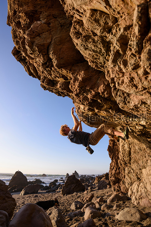 Harry Rochford climbs a boulder problem called Tectonic Traverse (V3) on the Sonoma Coast near Bodega Bay, California